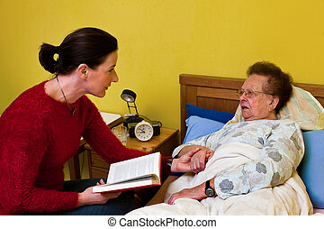 Sick old woman is visited by - Patient is attended by senior...