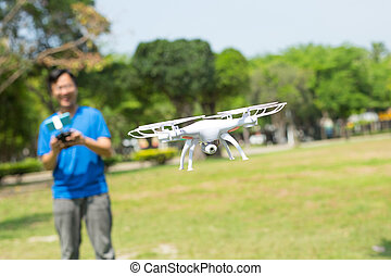 man play drone in park - man play drone in the park happily,...