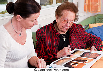 Senior citizen in this gallery scrolls - An old woman leafs...