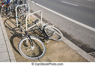 Bicycle parking rack - Bicycles tied safety on a street...