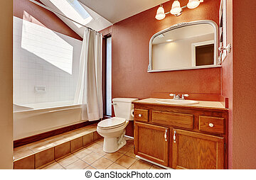 Interior of old style bathroom in brown color with tile floor
