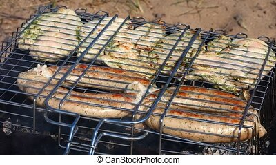 Barbecue - Sausages and meat roasting on the grill