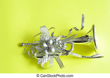 Silver trumpet to decorate a Christmas tree isolated against...