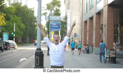 man jumping for joy in the streets. overjoyed.
