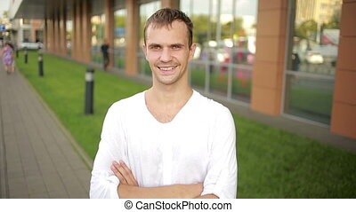 sweaty man smiling on the street hot weather joyful man -...