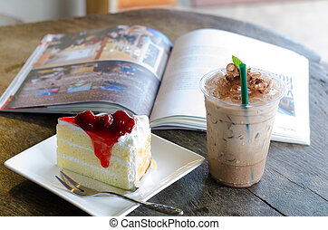 strawberry cake and Ice coffee on wooden table