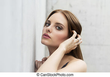Fashion model portrait of face with beautiful blue eyes