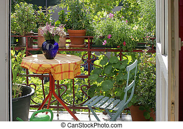balcony with flowers and plants - view of a city-balcony in...