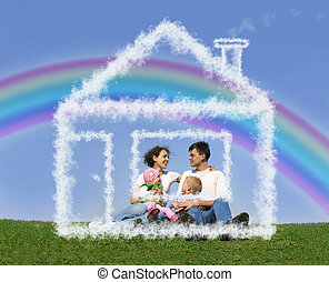 family of four sitting in dream house and rainbow collage