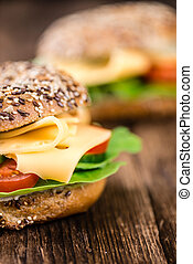 Breakfast Bagel (with cheese; selective focus) on an old...