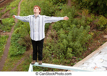 man guy is falling from the bridge