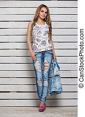 Pretty blonde posing in blue jeans