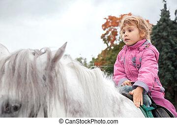 teen girl riding horse