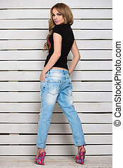 Young woman posing in blue jeans