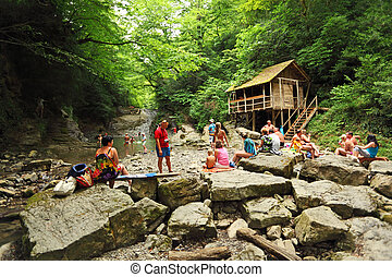 SOCHI, RUSSIA - JULY 15 People near a waterfall in Sochi, Russia. This year the resorts of Big Sochi expect to have about 4.4 million vacationers, or about 400 thousand more than in 2008. Sochi, Russi