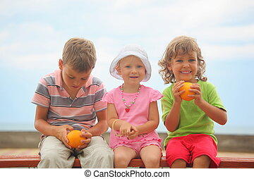 boys and girl with oranges and one liittle girl with panama...