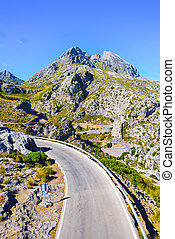Winding road descending through mountains to Sa Calobra on...