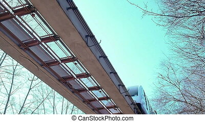 Monorail trains on the road. The view from below. - The...