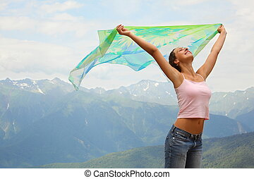 beautiful joyful woman with kerchief she is looking at sky...