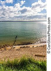stony beach, sea and island.