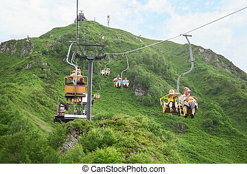 KRASNAYA POLYANA - Jule, 17: Cable way is serving ski-run...