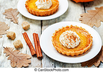pumpkin pie decorated with whipped cream. toning. selective...