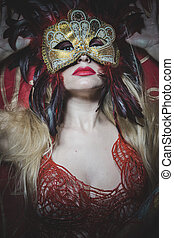 Blonde with gold mask on red cloth embroidered golden...