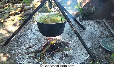 Camp food tourists Food in the pot over the fire Cooked on a...