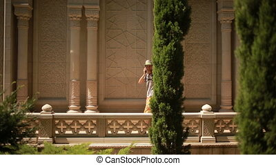 beautiful man walking on the Arabic palace. talking on the...