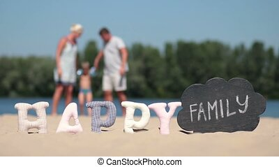 Blurred background of family playing on the beach