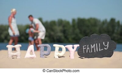 Blurred background of family hugging on river bank
