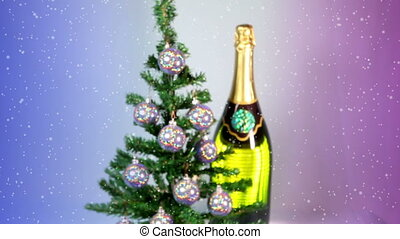 New Year's balls on a New Year tree and a huge bottle of sparkling wine