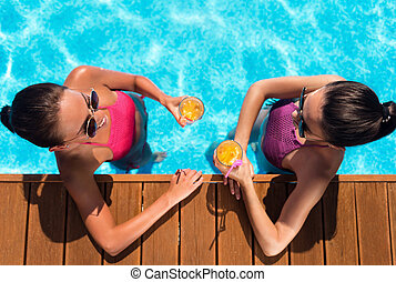 Cheerful friends resting in a swimming pool - Lets get it...