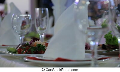 Various kinds of delicious food stand on table in banquet...