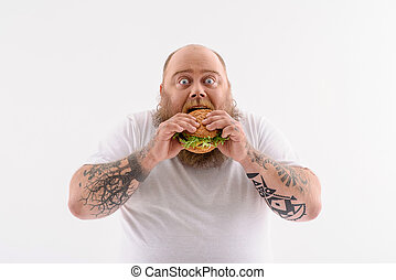 What a wonderful tasty food - Fat man is eating sandwich...