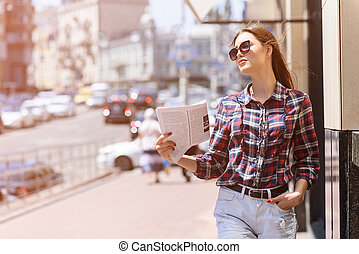 Cheerful girl saving from heat in city - Confident young...