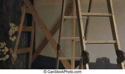 Metal stepladder stands in empty room which is prepared for reconstruction.