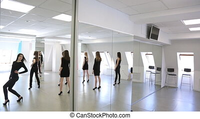 Girls in black clothes turn over to mirror one by one. They...