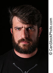 Bearded guy wearing shirt with serious look. Close.up. Black...