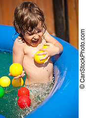 The child bathes in inflatable pool