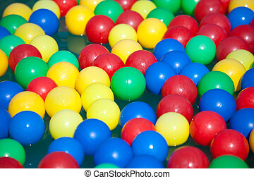 Multi-coloured balls float on water