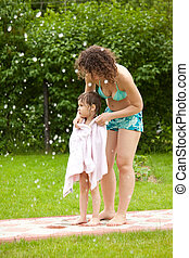Mum wipes the daughter a towel