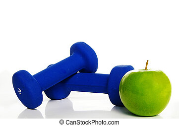 Two weights and a green apple, on white