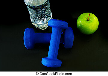 Water, green apple and two hand weights