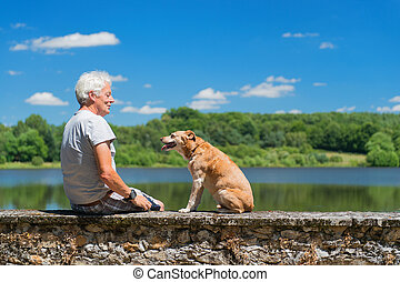 Senior man with old dog in nature landscape - Senior man...