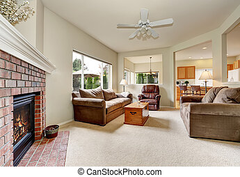 Cozy elegant family room with backyard view furnished with...