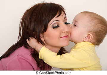Little daughter kissing her mother Close up Horisontal...