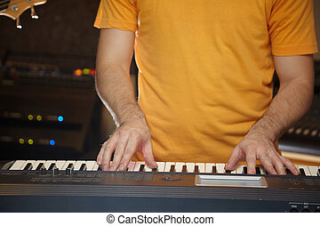 keyboard player is working in studio