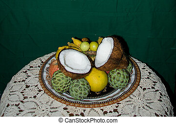 Tray of Fruits on Table - Offering of fruits and coconut...