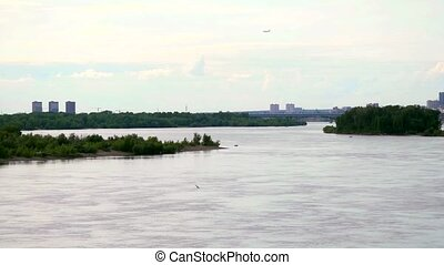 beautiful view of Ob River in Novosibirsk flying birds and...